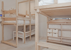 Childrens Playroom Bedroom with 2 bunk beds and 3 full size beds and toddler bed