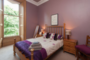 Double Bedroom 1 - This large double bedroom is presented in soft shades of purples, adding to the luxurious feel of the apartment. Also has large wardrobes and windows.