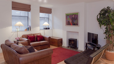 Sitting Room - Warm, cosy with designer touches such as the barcelona chairs!