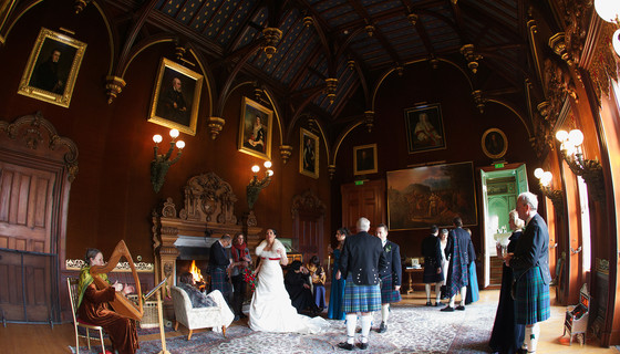 Wedding party in the main hall of Murthly estate - The wedding party celebrates in the reception rooms at Murthly Castle before heading to the walled garden (© Nigel Lumsden)