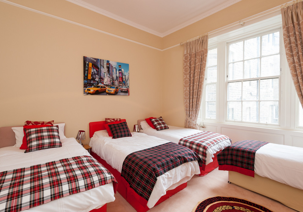 New York Room with a bit of our Scottish tartans - Our guests just love this fun packed room.  Sleeps 5 and very spacious.  Want to all be together then this is the one.