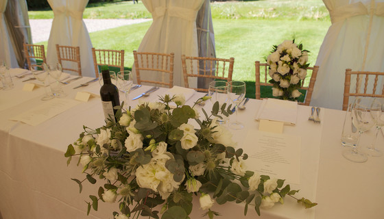 Head table awaits the bride and groom in Murthly gardens - A garden tent or marquee - set for the wedding reception of the newly weds in Murthly Castle walled garden (© Nigel Lumsden)