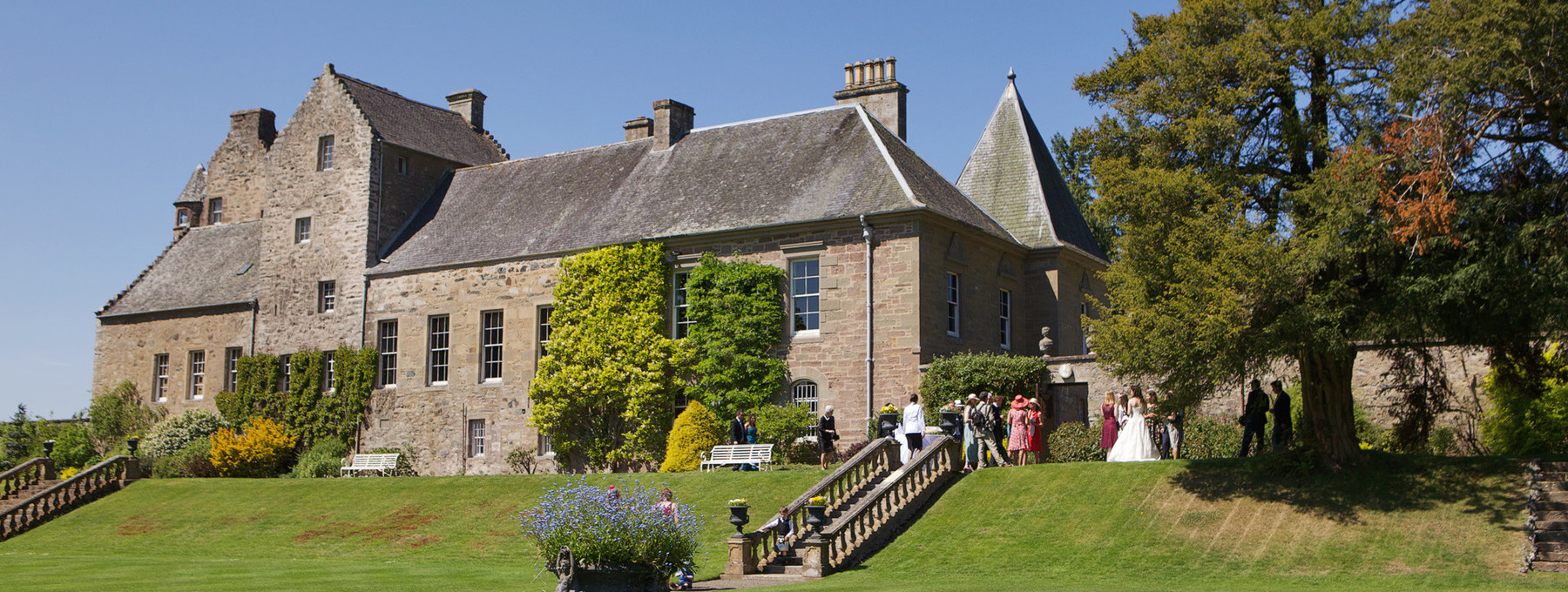 Murthly Estate facade from the garden - A lovely, clear day in Murthly is ideal for a wedding - gardens in full bloom.