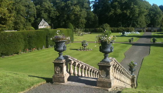 Descending into Murthly estate gardens - The stone stairs and manicured gardens of Murthly castle are ideal for corporate and event hire.