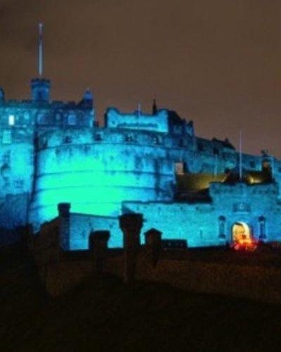 CastleEsplanade_02 - View of Edinburgh castle lit up in blue light at night