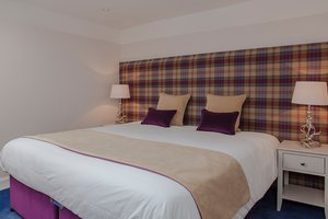 One of two bedrooms on the second floor, which are charmingly decorated to the highest standard with a Scottish flare. Furthermore, the Super-king bed can be transformed into two twin beds if desired.
