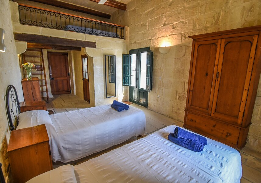 17. Twin bedroom with ensuite overlooking garden and church views