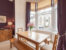 CoatesGardens-3 - Wooden family dining table in large bay window of Edinburgh holiday let