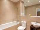 Main Bathroom - Shower over bath tub. Mains operated shower from combi-boiler