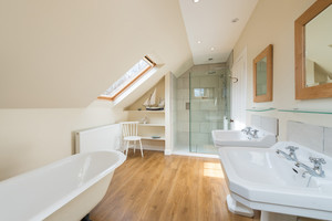 Bathroom with double sink, roll top bath and walk-in shower