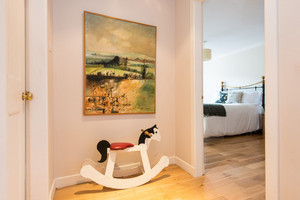 Albany Street Townhouse Hall - A rocking horse in the hallway, looking through doorway to double bedroom