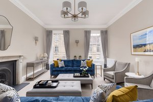 Elegant Drawing Room in Georgian Townhouse with striking blue sofas.