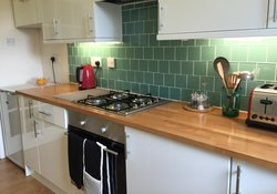 The lovely kitchen has everything you need to cook a meal or heat up your take-away