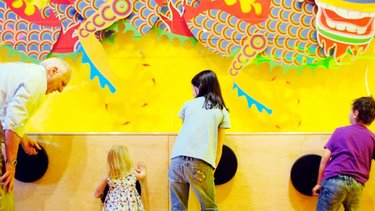 Family playing in the Imagine Gallery at the National Museum of Scotland in Edinburgh