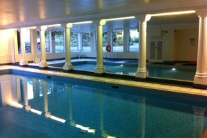 Large shared pool inside luxury apartment complex in Edinburgh