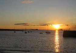 Sunset across the West Bay towards The Lamb & Fidra