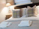 Parkgate (Holyrood Road) 9 - Cosy double bedroom with decorative tartan patterned cushions