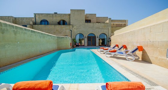Gozo villa with private pool - Swimming pool and loungers around it