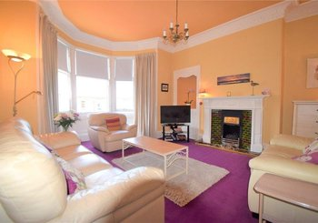 Joppa Park 1 - Bright, airy living room feature bay window and high corniced ceiling in Edinburgh holiday home.