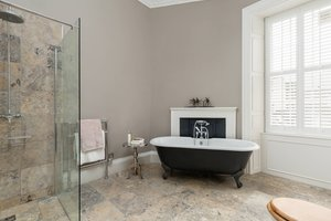 Large Ensuite Bathroom with roll top bath.
