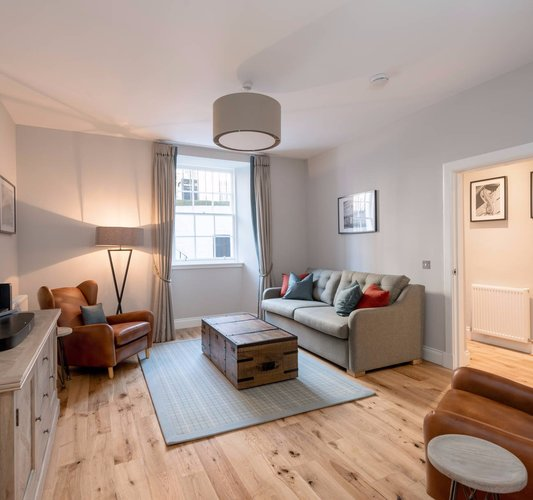 Stafford Street Apartment Lounge - Spacious lounge with grey and brown colour scheme in Edinburgh West End apartment.