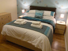 King-size bed - Bedroom with king-size bed, wardrobe and lots of drawer space