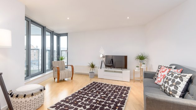 SandportWay-00013 - Spacious, contemporary living room featuring floor to ceiling windows in Edinburgh holiday apartment.
