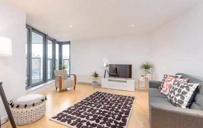 Sandport Way 1 - Spacious, contemporary living room featuring floor to ceiling windows in Edinburgh holiday apartment.