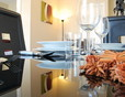 Dining Area - The apartment features sharp modern furniture throughout.
