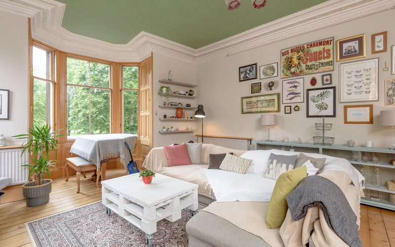 Millerfield Place 1 - Family living room with large bay window providing green views in Edinburgh holiday let