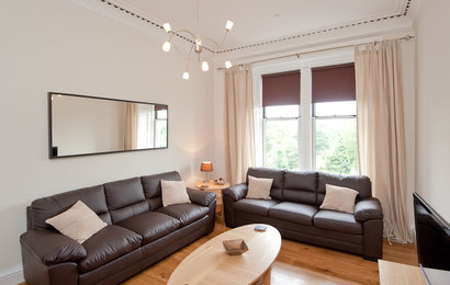 Ardmillan Terrace No.2 1 - This living room, the first of two in this fantastic apartment, features three full size leather sofas, one of which becomes a sofa bed if required.