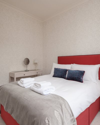 Coates Gardens 3 - Double bedroom with decorative cushions at Edinburgh holiday let