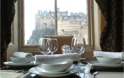 CastleEsplanade_01 - Detail of family dining table with view to Edinburgh Castle