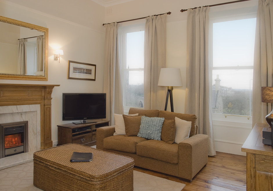 Lounge - The lounge is elegantly decorated with attention to detail. The large windows and focal fireplace add to the warm and relaxing vibes of the lounge. (© The Edinburgh Address)