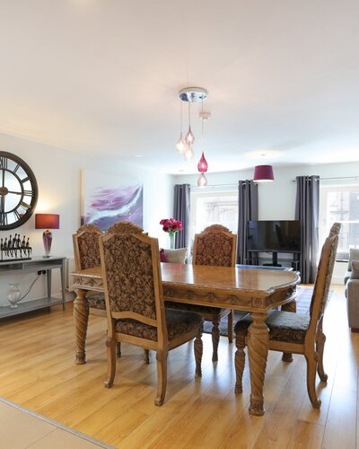 1V7A9413 - Dining table and chairs in open plan Edinburgh apartment.
