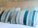 Drummond Street 9 - Detail of decorative stripy cushions in Edinburgh holiday let