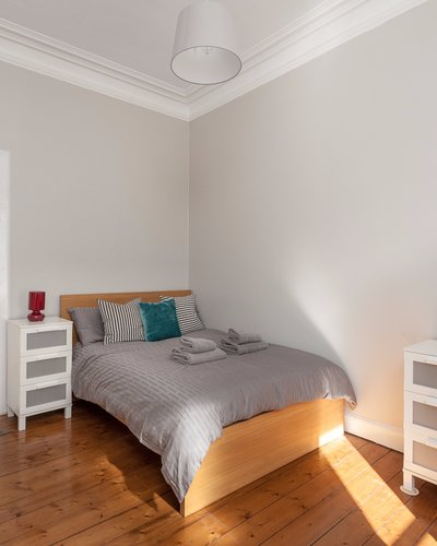 Warrender Park Road 3 - Double bedroom with decorative stripy cushions and plentiful guest storage
