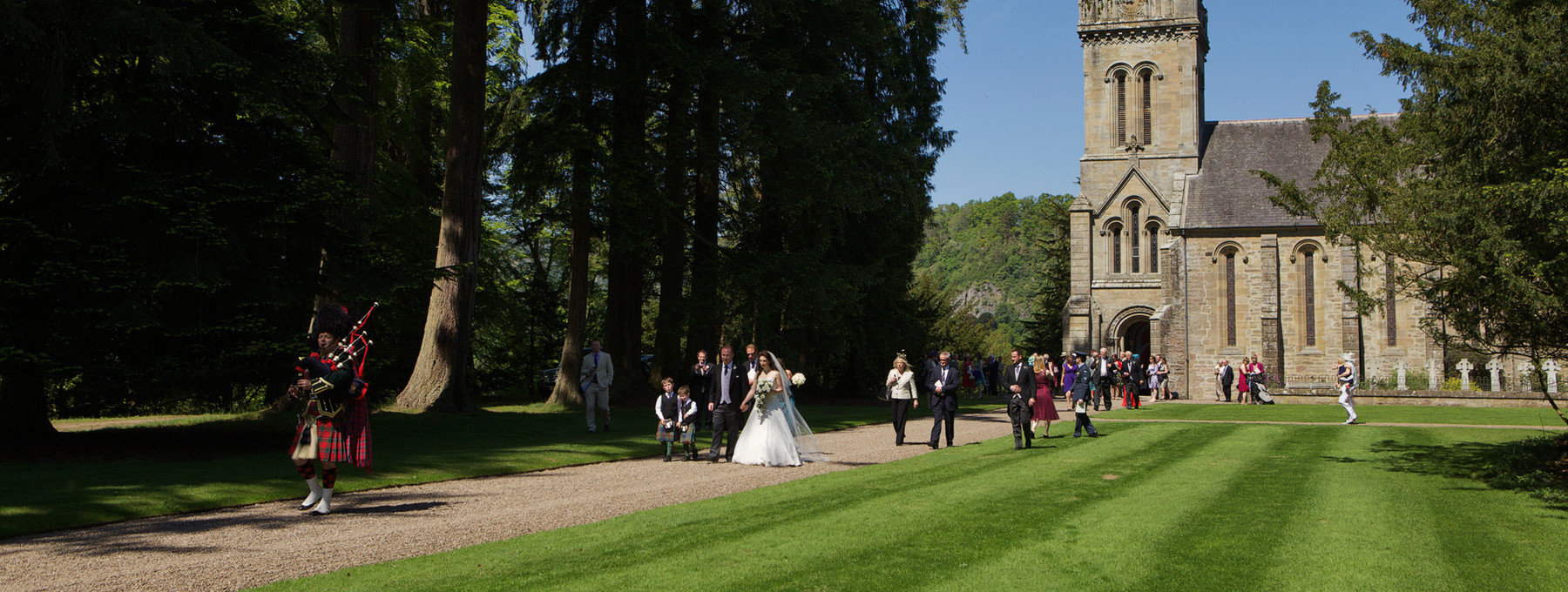 Murthly Castle Chapel wedding procession - Newly weds follow the Piper from Murthly Chapel to Murthly Castle (© Nigel Lumsden)