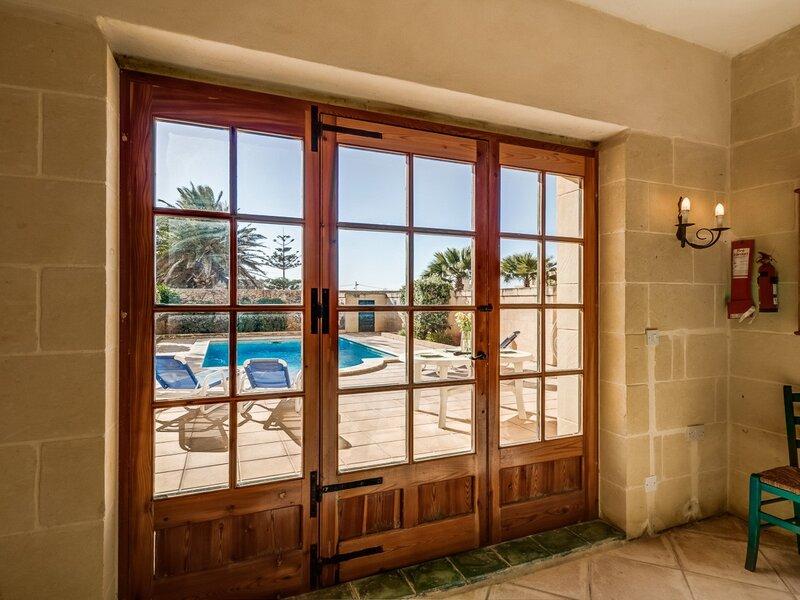 13. Dining area door leading onto pool area
