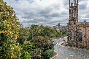 Street view of Buckingham Terrace in Edinburgh West End with church building on corner.