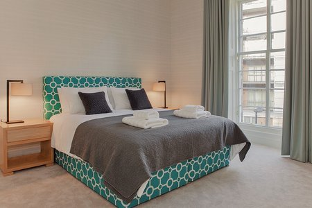Bedroom - Modern and stylish bedroom complete with superior king-sized bed and floor to ceiling window. (© The Edinburgh Address)