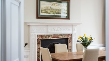 Spacious Dining Room - Bright and grand with period fireplace. (© The Edinburgh Address)