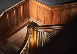 The wood panelling on the staircase