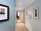 Parkgate (Holyrood Road) 8 - Hallway with framed pictures looking towards family living area