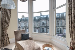 Coates Gardens Apartment Drawing Room - Large bay windows looking out onto Edinburgh street.
