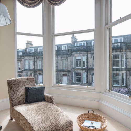 Large bay windows looking out onto Edinburgh street.