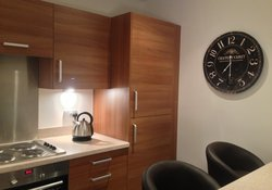 Kitchen equipped with bar stools and luxury clock!