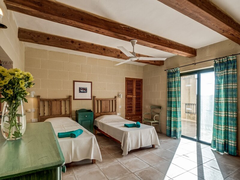 18. Twin bedroom with terrace overlooking pool area