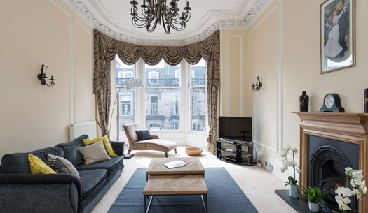 Coates Gardens Apartment Drawing Room - Spectacular Drawing Room with large bay windows, chandelier and fireplace within Edinburgh holiday apartment.