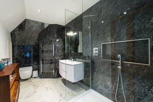 Black and white bathroom with large walk-in shower